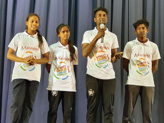Players speaking to secondary school students about participating in the Street Child Cricket World Cup