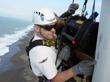 Bangui-EFC-Robert checks sanding windblade leading edge