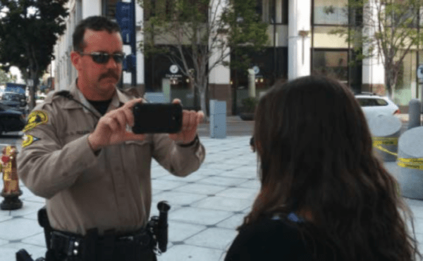 Law enforcement officer taking a photo with a mobile device