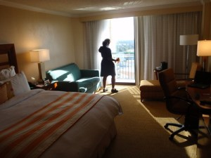 housekeeper cleaning hotel room
