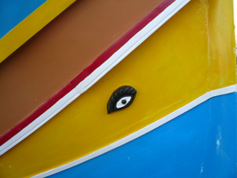 A bright eye painted on a yellow background