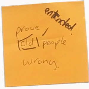 """A Post-It note saying """"prove old people wrong"""". Someone has added a note to the word """"old"""" that says """"entrenched"""""""