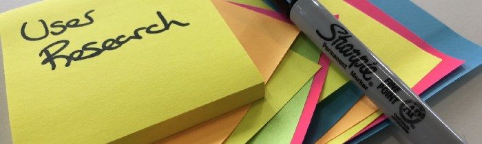 sticky notes with user research written on them