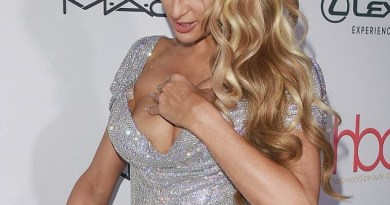 Busty Paris Hilton suffers a DOUBLE wardrobe malfunction as she almost spills out of her low-cut dress before getting her heel caught at Hollywood Beauty Awards