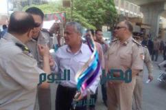 العالكى يقود حمله امنيه مكبره على الاشغالات والعشوائيات بشوارع طهطا  