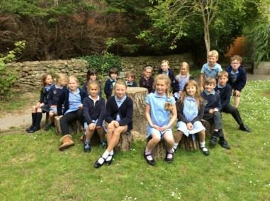 Children enjoying the new tree seats