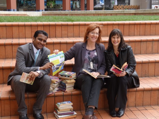 Secretary of Fijian High Commission Niraj Mudaliar, Mayor Celia Wade-Brown and Eileen Mueller with the Mayor's childhood books that she donated to Fijian school children to improve their literacy