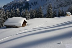 snow covered alpine huts