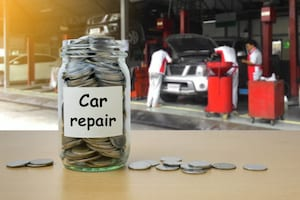 money saving for car repair in the glass bottle