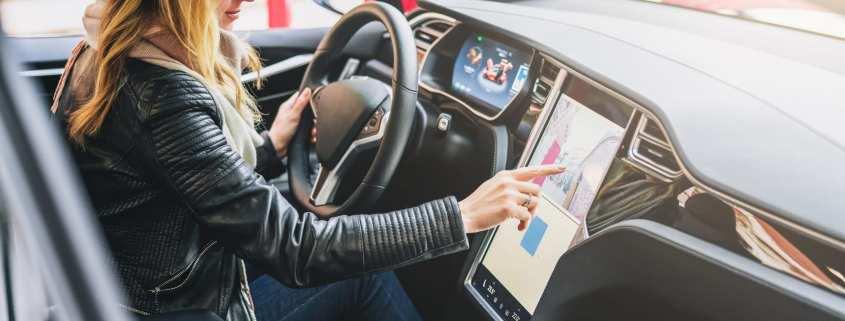 woman driving Tesla