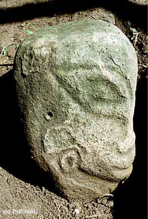 Monolith number 10 (total height 42.3 cm) was excavated on property belonging to the Omenckngkar family at Melekeok and is called by the name of a god, Mengachui. It is an example of figure type variety B5. Photo by David C. Ochsner, ©1987 Jo Anne Van Tilburg.
