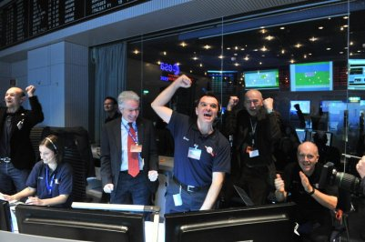 The Rosetta mission flight team after receiving news of Philae's comet touchdown. Our editor Emily in the left corner.
