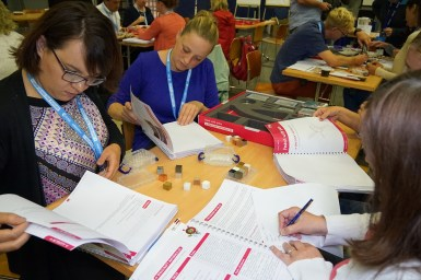 Teachers exploring the resource booklets.