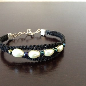 3 strand fine cord and wire bracelet decorated with pearl and seed beads.