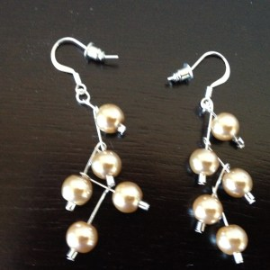 Cascading peach pearl drop earrings