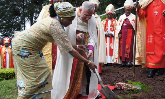 LWF Council member Ms Titi Malik and LWF President Bishop Munib A. Younan plant a commemorative tree for the 60th anniversary of the first Lutheran conference in Marangu. Photo: LWF/Tsion Alemayehu