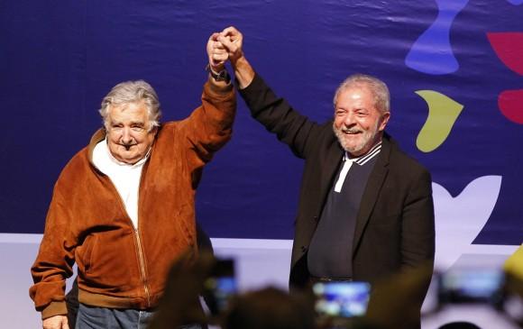 José Mujica (derecha) respaldó el proceso de paz. FOTO: JAIME PÉREZ