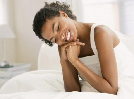 woman-smiling-n-bed