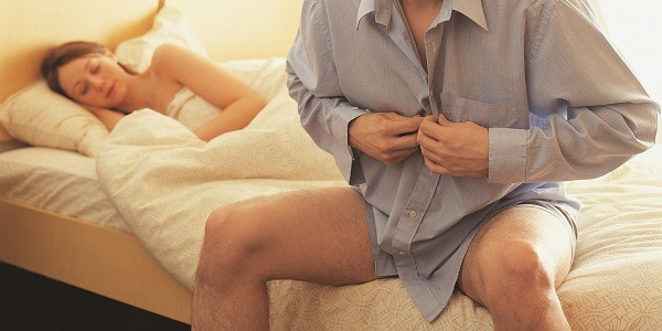 man dressing up in bed