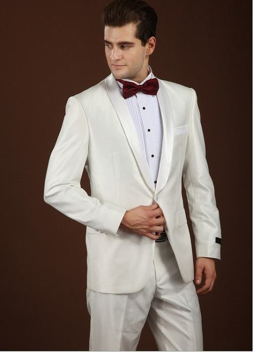 white jacket on white trouser with dark red bow tie