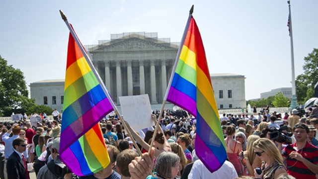 Hundreds of people gather outside the US Supreme Court building in Washington, DC on June 26, 2013 in anticipation of the  ruling on California's Proposition 8, the controversial ballot initiative that defines marriage as between a man and a woman. The US Supreme Court on Wednesday struck down a controversial federal law that defines marriage as a union between a man and a woman, in a major victory for supporters of same-sex marriage.The Defense of Marriage Act (DOMA) had denied married gay and lesbian couples in the United States the same rights and benefits that straight couples have long taken for granted. AFP PHOTO / MLADEN ANTONOV        (Photo credit should read MLADEN ANTONOV/AFP/Getty Images)