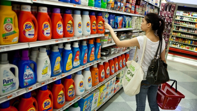 A shopper reaches for a Procter & Gamble Tide brand laundry detergent in a supermarket in New York, U.S., on Tuesday, Aug. 3, 2010. Photographer: Ramin Talaie/Bloomberg