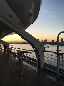Looking out over the deck of the Queen Mary, beneath a lifeboat.