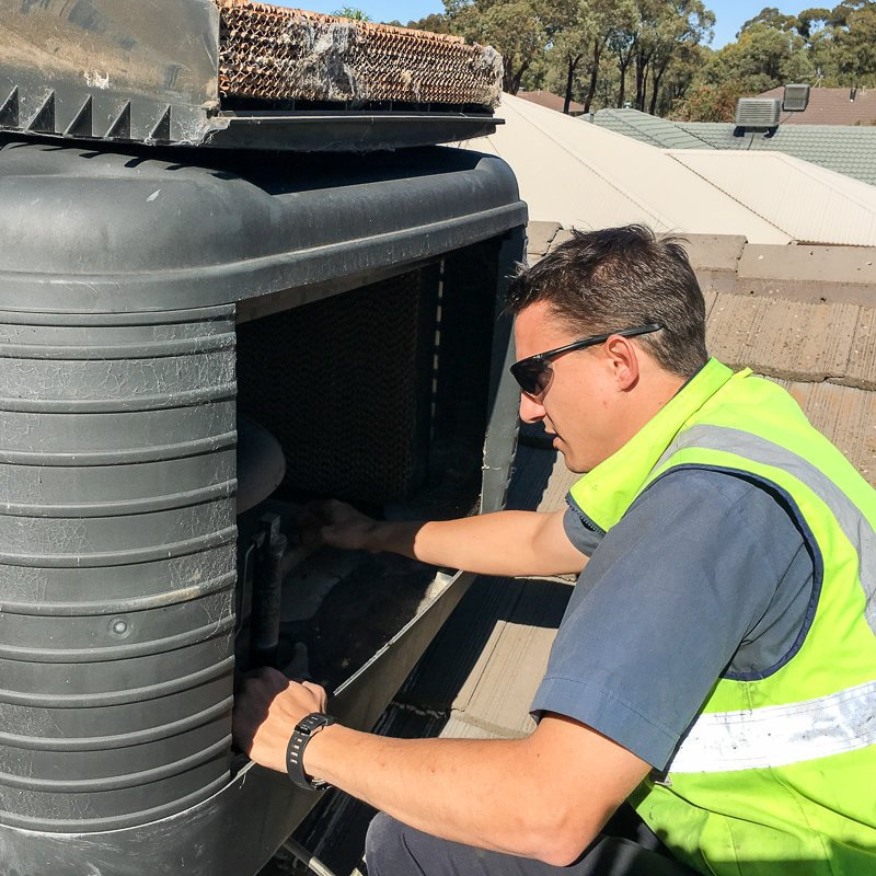 Electrican maintaining Evaporative Air Condtioner