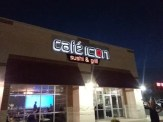 Picture of Cafe Icon illuminated wall sign after installation.