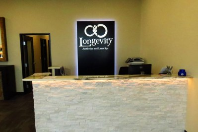 Picture of lobby sign for Laser Spa reception area.