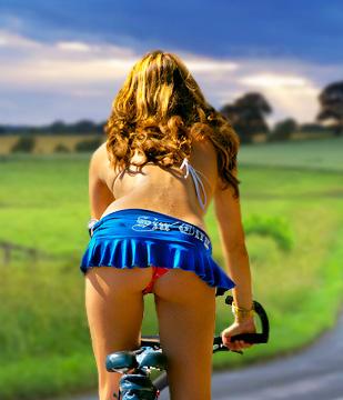 Lady on a bike cross-county