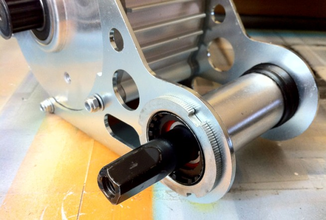 Here's a BB cartridge and mid-drive bracket from the GNG to show the method that's becoming common.
