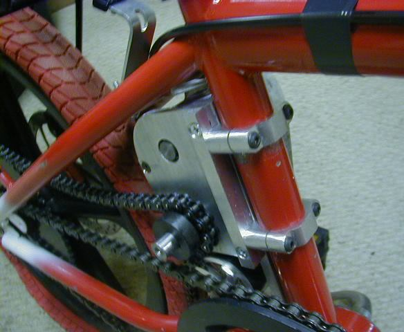 Thuds DIY 2-speed transmission driving a parallel right-side drive so the rear disc brake can still be used.