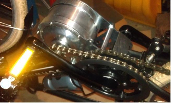 Here it is upside down, and this is a good pic of the tiny 9T drive sprocket.