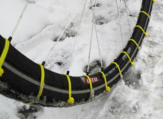 """Cheap plastie """"tie wraps"""", sometimes called """"zip ties"""" can add a little extra traction, and they are easy to install."""