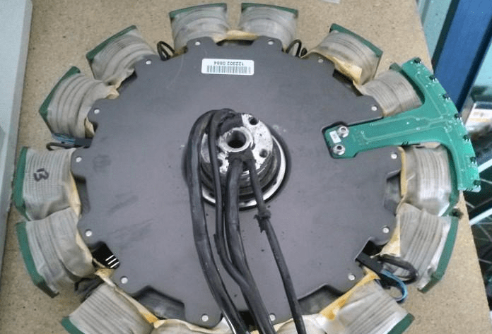 The stator from the Tidalforce motor from Wavecrest (no longer in business). Notice the phase wires pass through a fattened section of the axle center , instead of through a hollow axle.