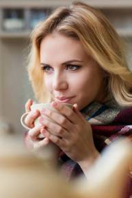 Beautiful woman enjoying the benefits of a best espresso machines home