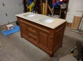 Here's the new FREE vanity cabinet and top. It was a dark golden stain, which my wife wanted to be painted an espresso brown.