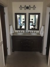 Here it is installed. New double mirrors (painted to match) and light fixture which we got lucky on the color.