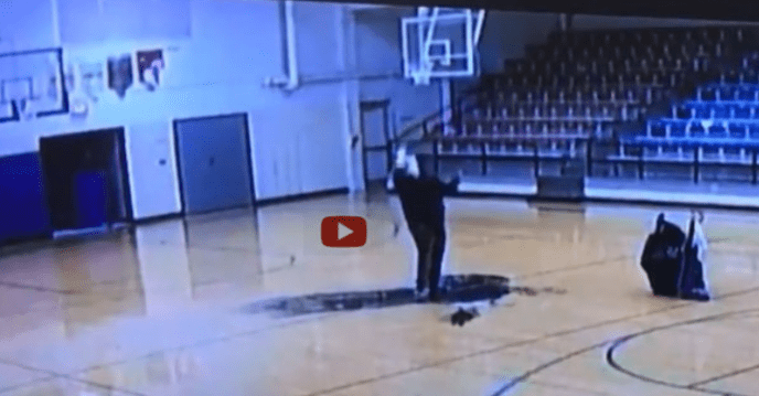 Janitor makes half-court shoht and makes it with his back to the basket! (image)