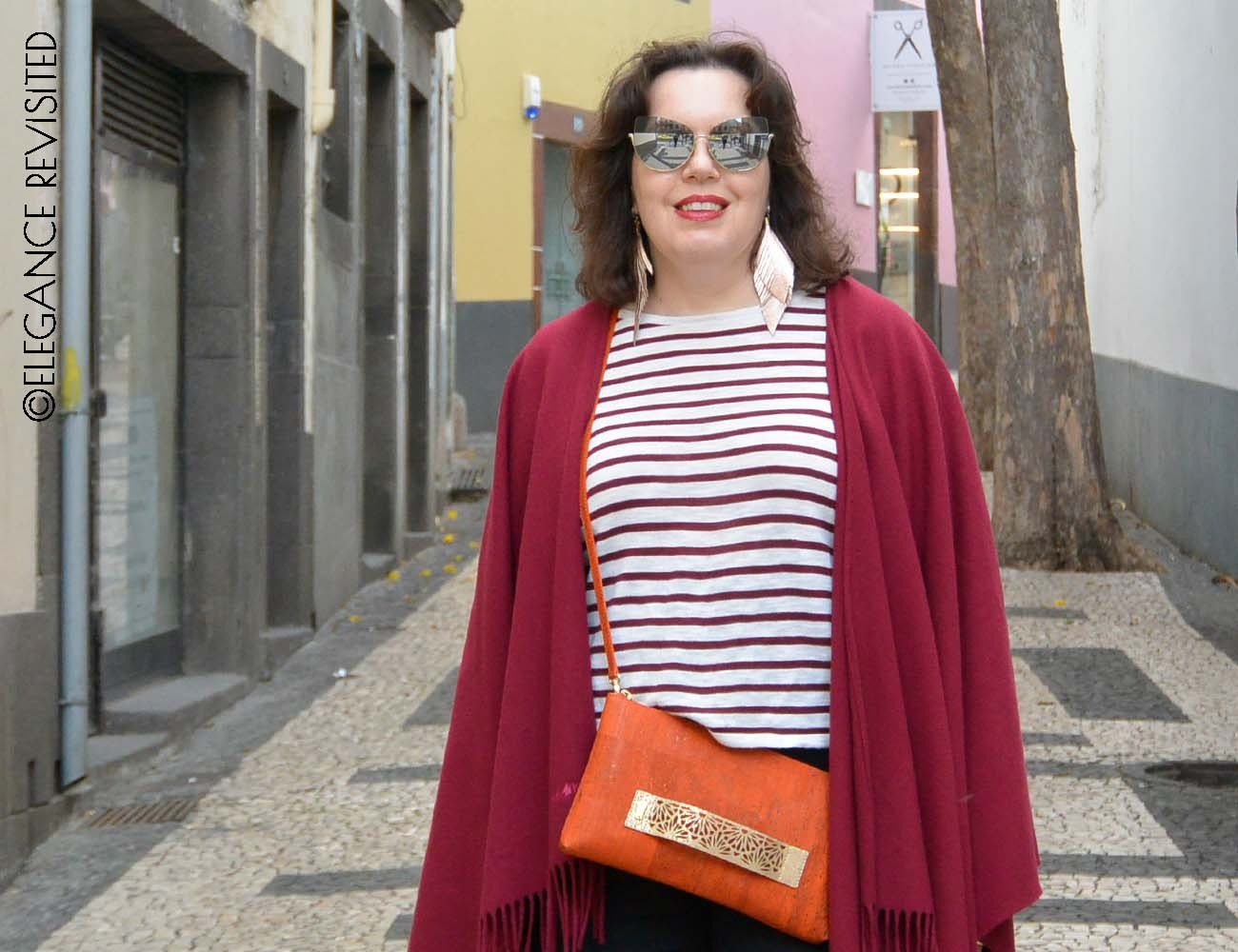 how to wear a poncho over 50