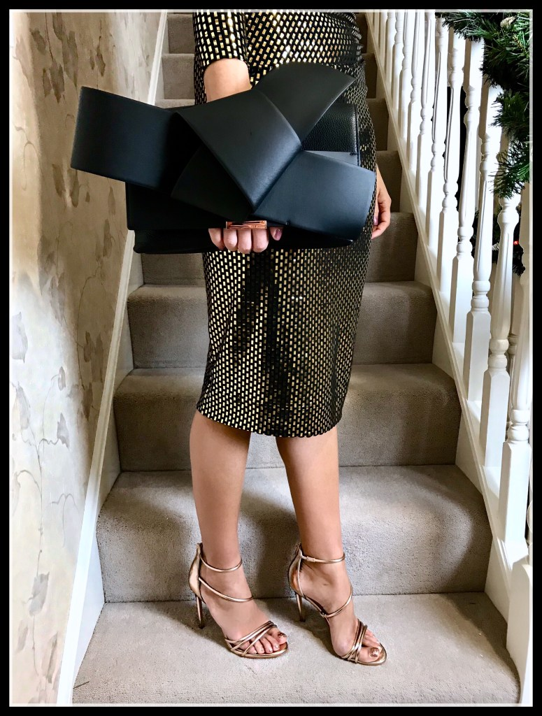 VIVIENNE WESTWOOD ANGLOMANIA Laminated Thigh Dress | Ted Baker Giant Knot Clutch Bag and | pair of rose gold Office Tubular Strap Sandals