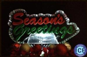 Seasons greatings with color ice sculpture