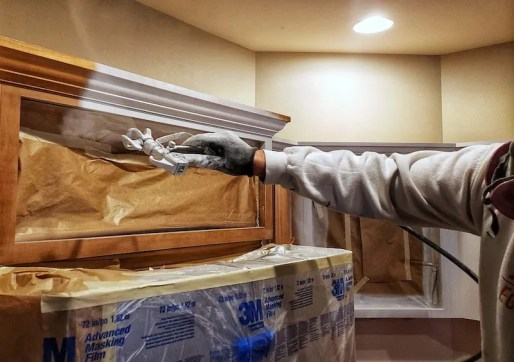 Spraying primer on cabinets