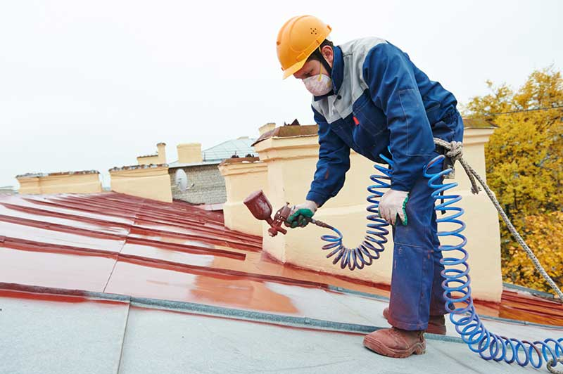 Pleasanton CA metal roof installation being painted red