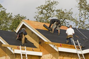 Group of roofers working installing a new roof in the bay area