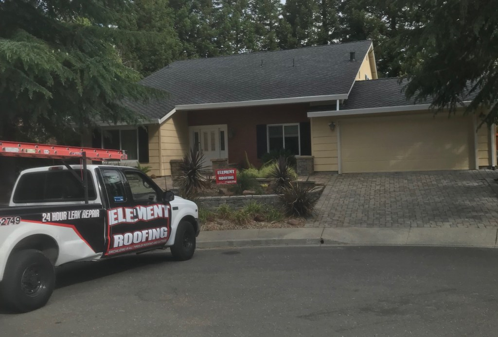 element roofing truck in front of a customer's home