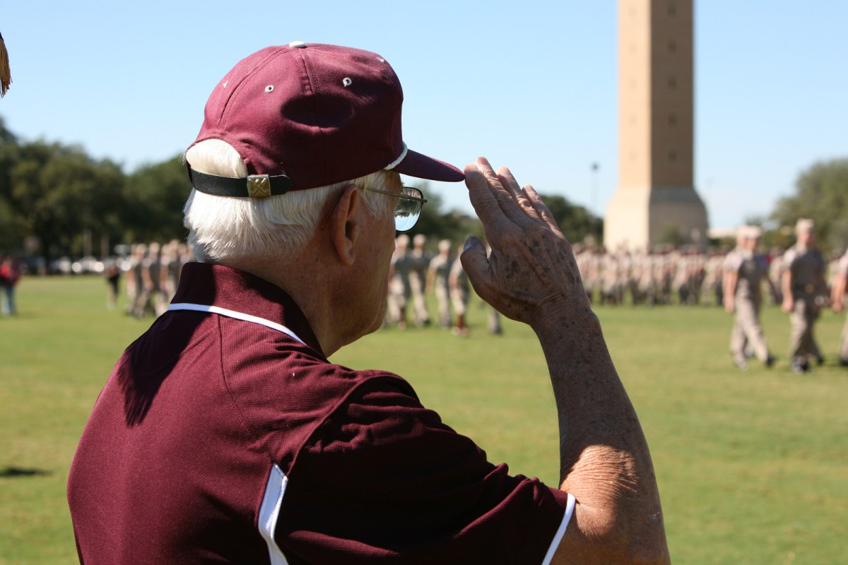 Veteran saluting Corps of Cadets at Texas A&M University