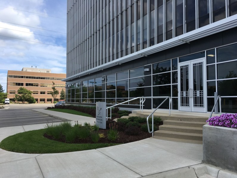 Low plantings around office building ground sign create pedestrian scaled environment.