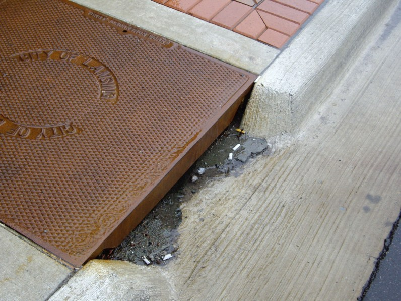 Debris is deposited when water slows down to change direction and flow into a catch basin.